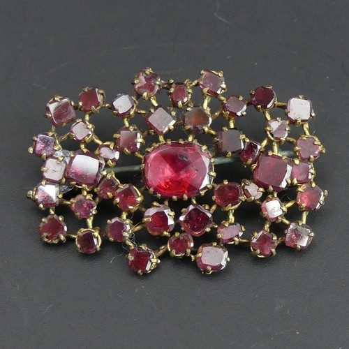 9 - Georgian foil backed garnet brooch set in yellow metal (un-tested). 6.6 grams. 42mm x 28mm....