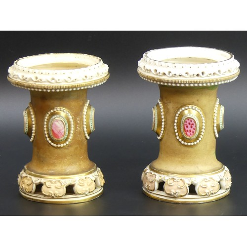 20 - An unusual pair of Bloor Derby porcelain vases with faux cabochon stone mounts. 14cm high.