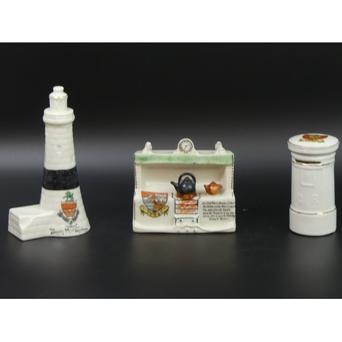 55 - Three items of crested china, lighthouse, post box and a range. Tallest 14.5cm....
