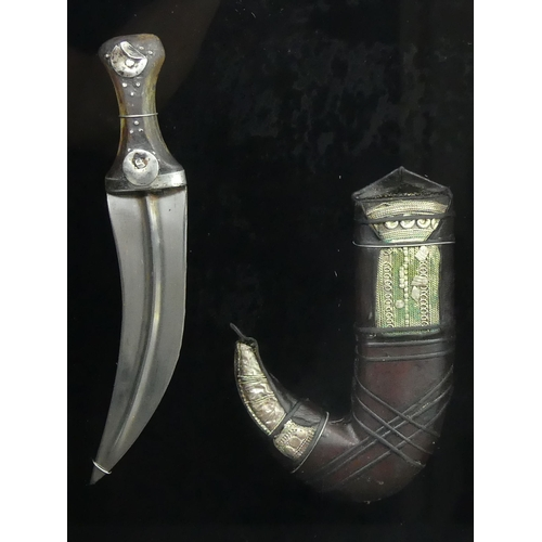 13 - 19th century Persian silver mounted dagger, framed and glazed. 40 x 29cm. UK Postage £20.