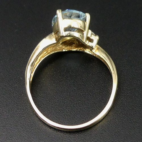 16 - 9 carat gold blue topaz and diamond ring, size N 1/2. 3.2 grams. Head 10.7mm band 1.8mm. UK Postage ...