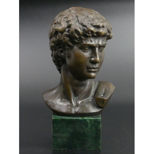 23 - A bronze bust of David on a marbled base. 17.5cm high. UK Postage £15.