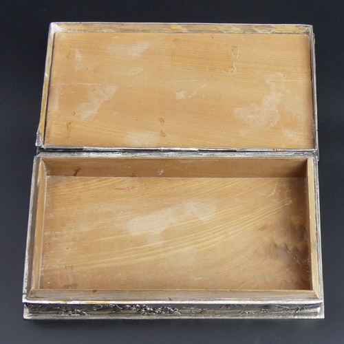 24 - Antique Chinese white metal (un-tested) cedar lined cigar or cigarette box. 19 x11 x 3.5cm. 938 gram...