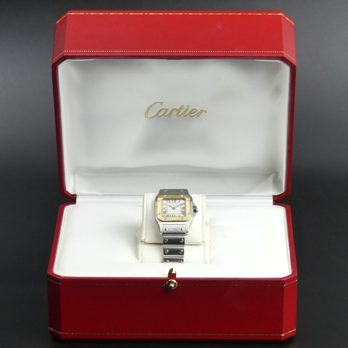 26 - Ladies 18ct and Stainless Steel Cartier Santos quartz watch, with the original box and papers. Watch...