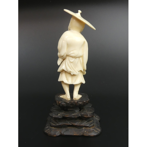 33 - Meiji period Japanese carved ivory Okimono of a fisherman. 13.5cm high. UK Postage £15.