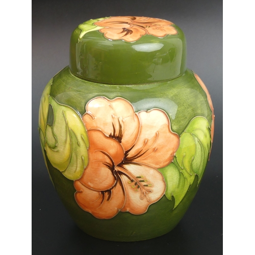 35 - Moorcroft Coral Hibiscus design ginger jar and cover. 16cm high. UK Postage £15.