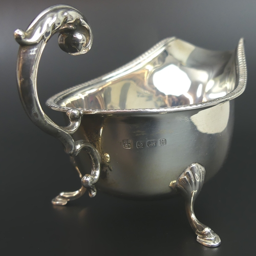 36 - George V silver sauce boat, Birmingham 1932. 90 grams. 16cm long x 8.7cm high. UK Postage £15.