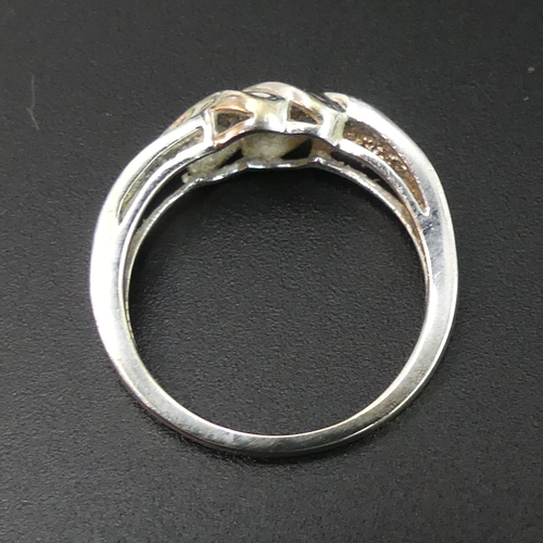 40 - 9 carat white gold diamond twist ring. Size N 1/2. Top 8mm wide band 1.8mm wide. 2.5 grams. UK Posta...