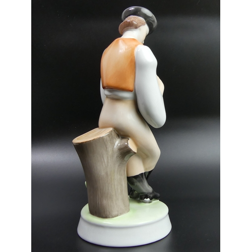 42 - Zsolnay Pecs Hungary porcelain figure of a man playing a flute. 26.5cm high. UK Postage £15.