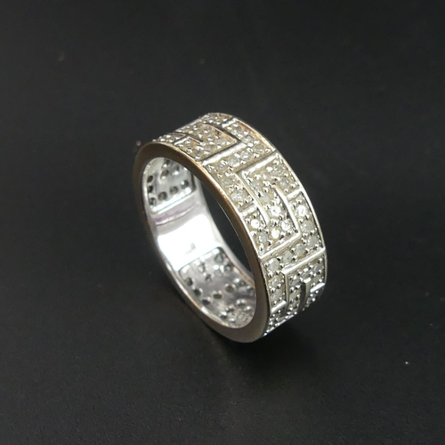 57 - 9ct white gold diamond set eternity ring, 1 carat stated diamond weight. Size R. 7.7mm wide. 5.5 gra...