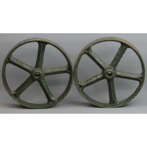 177 - A pair of Victorian cast iron painted wheels. 30 cm in diameter. UK Postage £30.