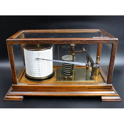 195 - Early 20th century mahogany and glass cased Barograph. 36 cm long x 20 cm high. UK Postage £25.