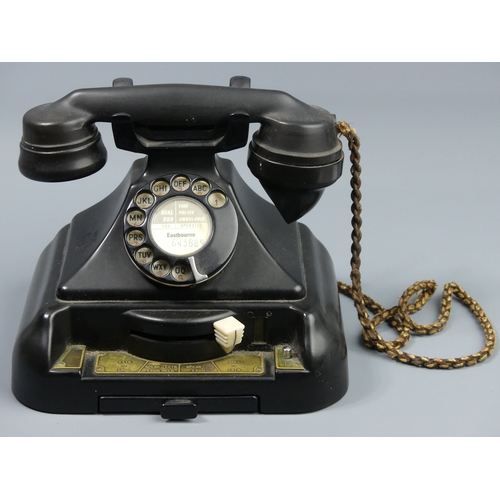 199 - Unusual black Bakelite telephone with an internal bell box and line switching function. 19 cm high. ...