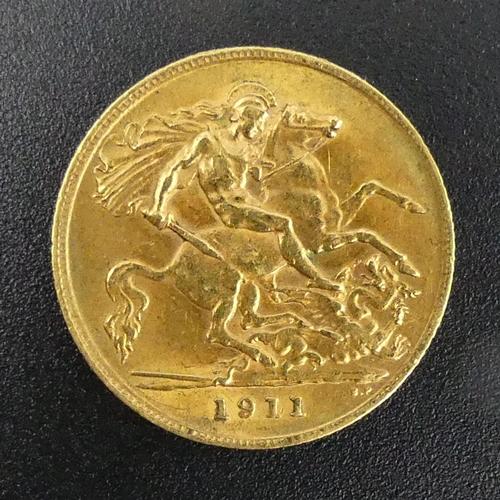 13 - George V 1911 half sovereign. UK Postage £12.