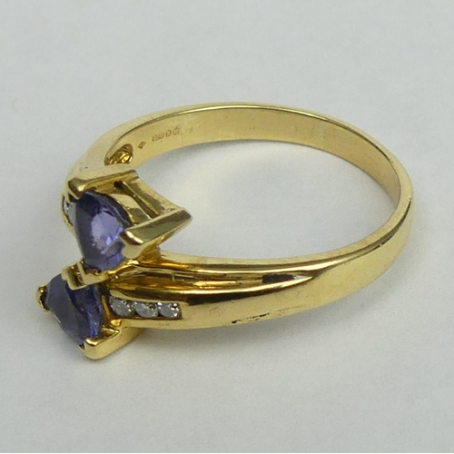18 - 18 carat gold Tanzanite and Diamond ring size S. Top 12.8 mm, band 2.7 mm. 6 grams. UK Postage £12.