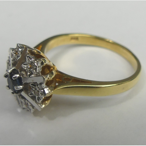 20 - 18 carat gold Sapphire and Diamond cluster ring, London 1977. Size P, top 12.2 mm. 5 grams. UK Posta...