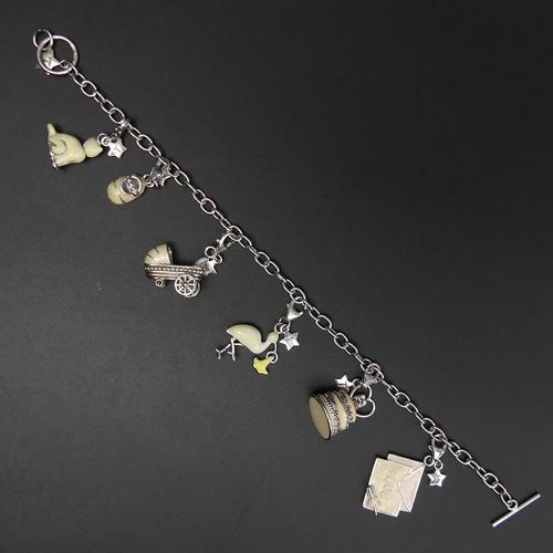 3 - Sterling silver and enamel charm bracelet. 19 cm long. 24 grams. UK Postage £10.