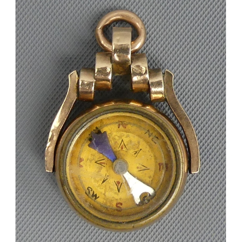 40 - Victorian 9 carat gold compass and Carnelian swivel fob, Birmingham 1893. 21 mm wide. 7.2 grams. UK ...