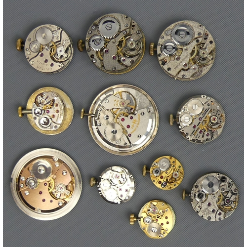 41 - A box of eleven watch movements including Girard Perregaux, Longines and Hamilton. UK Postage £12.
