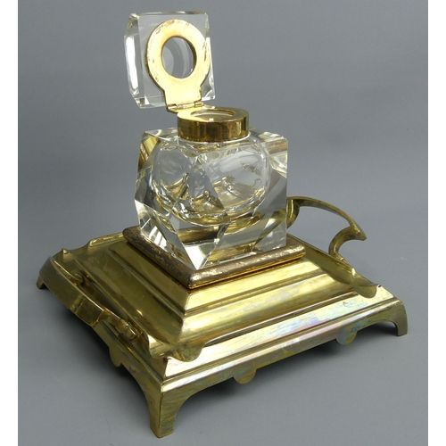 75 - A large Victorian brass and facet cut glass inkwell and stand. 15 cm high, 21 cm wide.  UK Postage £...