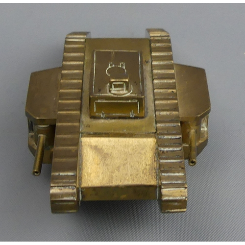 82 - Brass novelty inkwell in the form of a 1st world war tank, probably trench art. 10 cm long. UK Posta...