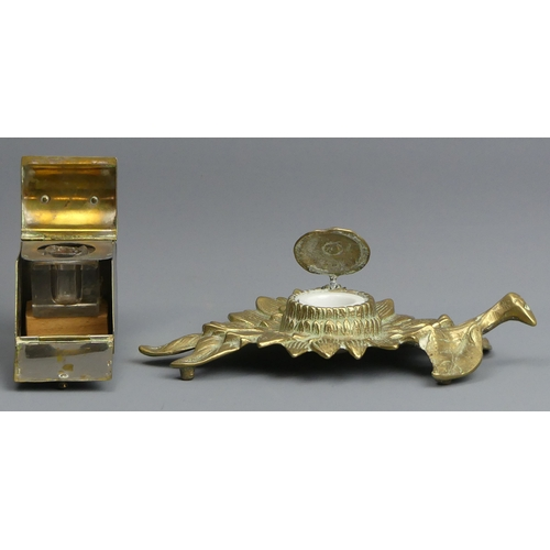 83 - Brass novelty inkwell in the form of a coal scuttle, c.1900 and a brass flower form example. 19 cm l...