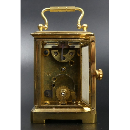 89 - Miniature brass carriage clock with 'Sevres' type panels. 8 cm high. UK Postage £12.