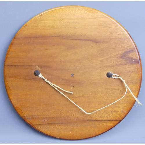 94 - Hand painted wooden wall plaque of an Australian Aboriginal hunter. 30 cm diameter. UK Postage £15.