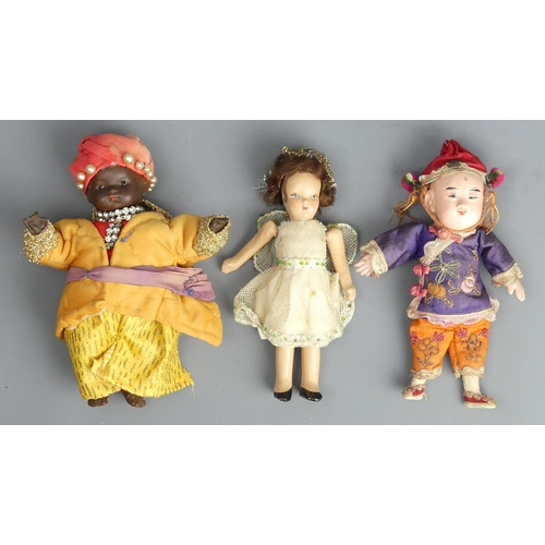 96 - Three old dolls, a Christmas fairy, a German bisque head example and an Oriental example. Largest 17...