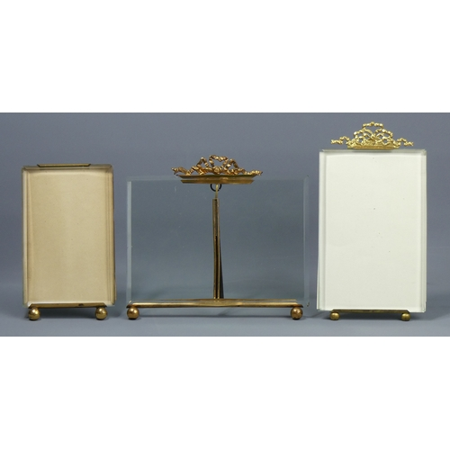 106 - Three Victorian/Edwardian gilt metal and bevelled glass photo frames, with easel backs. Tallest 17.5...