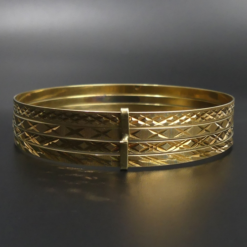 113 - A quartet of 14ct gold bangles with diamond cut decoration. each bangle 3.1 mm wide. 22.4 grams. UK ...