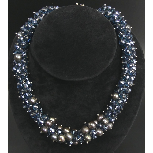 117 - A cultured tinted pearl and crystal choker necklace. 45 cm long x 2 cm wide. 149 grams. UK Postage £...