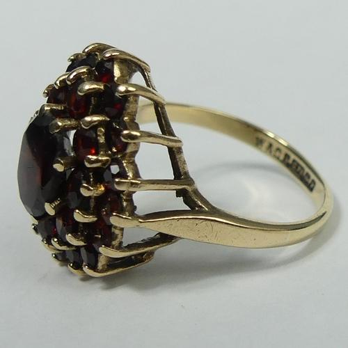 123 - 9 carat gold garnet cluster ring, Birmingham 1970. 3.5 grams. Size K Top 16.7 mm Band 2 mm. UK Posta...