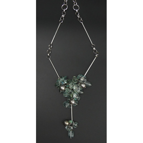 129 - Sterling silver and blue stone set necklace. 43 cm. 52 grams. UK Postage £12.