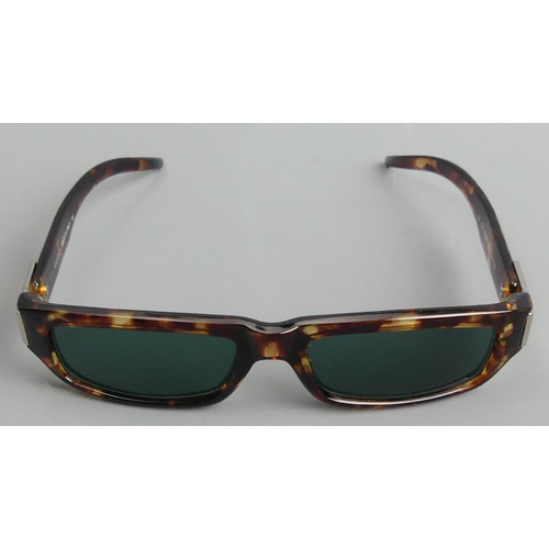 145 - A pair of Gucci Italian designer sunglasses and case. UK Postage £12.