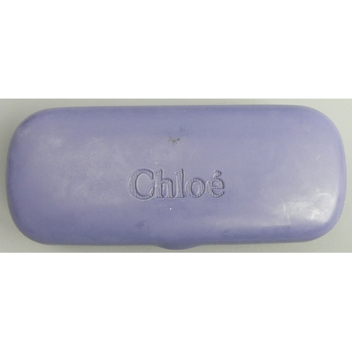 146 - A pair of Chloe French designer sunglasses and case. UK Postage £12.