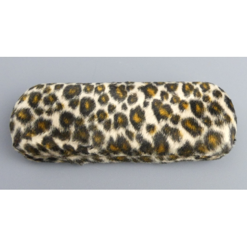 151 - A pair of Jean Paul Gaultier designer sunglasses and leopard skin case. UK Postage £12.