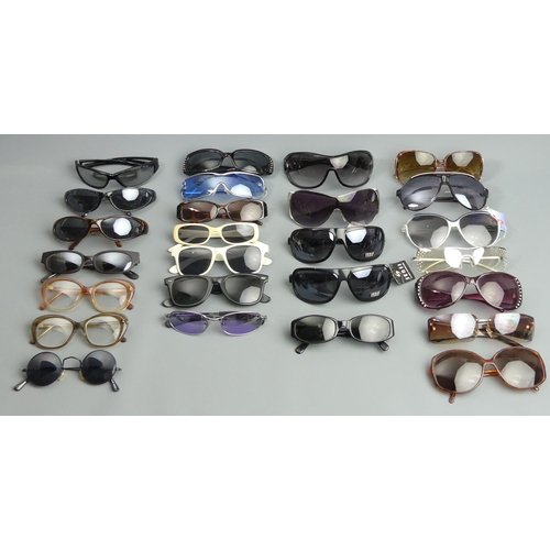 169 - A collection of various fashion sunglasses. UK Postage £15.