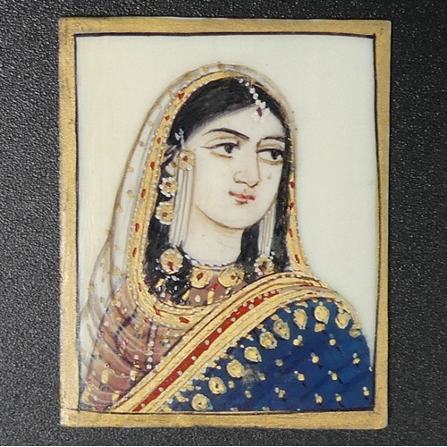 180 - An old finely painted Indian miniature watercolour portrait on ivory. 28 mm x 37 mm. UK Postage £12.