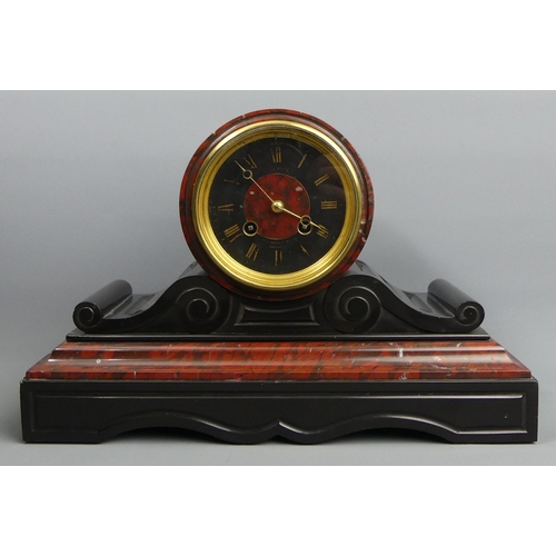 181 - A Victorian red and black marble mantle clock, striking on a bell, complete with pendulum and key. 3...