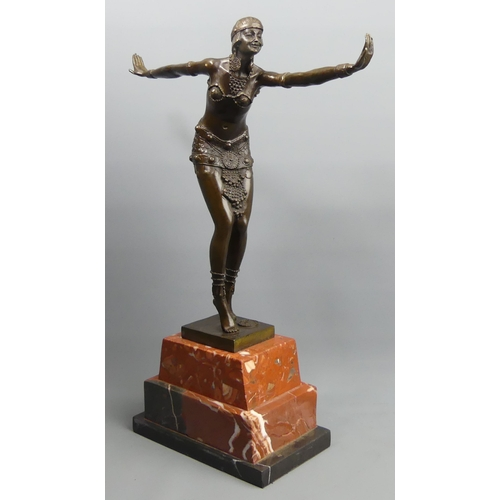 187 - A bronze Art Deco style figure on a marble plinth. 48 cm high. UK Postage £30.