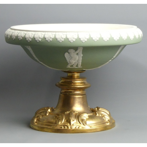 188 - A Victorian Wedgwood? green jasper dip comport on a gilt metal stand. 27 cm diameter x 19 cm high. U...