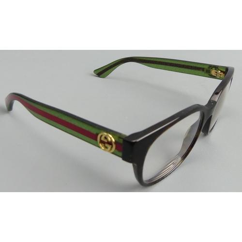 238 - A pair of Gucci Italian designer glasses. UK Postage £12.