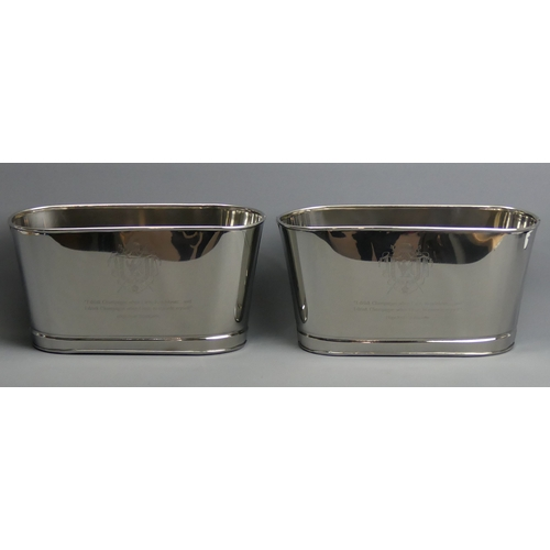 256 - A pair of oval Champagne ice buckets with quotes from Napoleon and Lily Bollinger to the sides. 30 x...