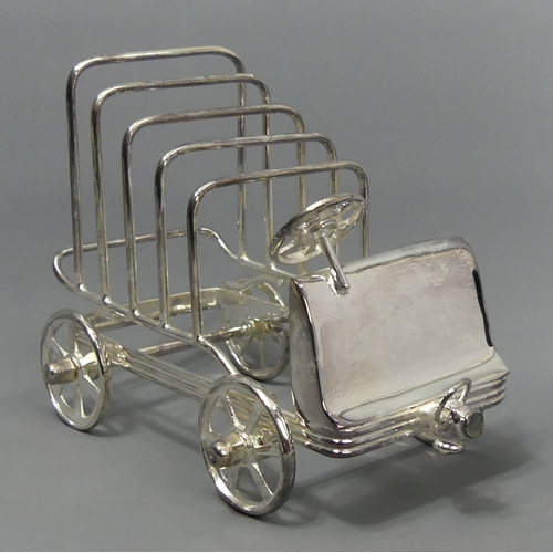 257 - Novelty silver plated toast rack in the form of a vintage car. 12.5 cm high x 16 cm long. UK Postage...