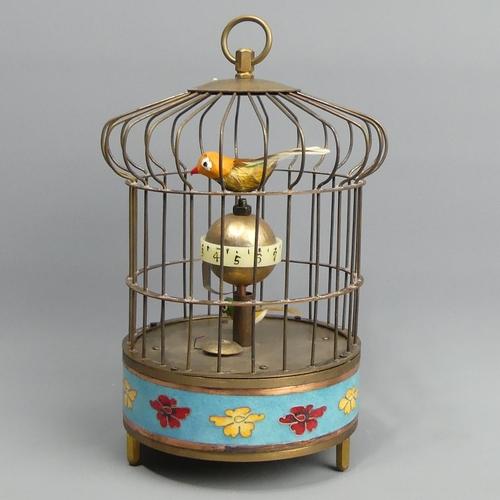 265 - Brass cloisonne bird design clock. 21 cm high. UK Postage £15.