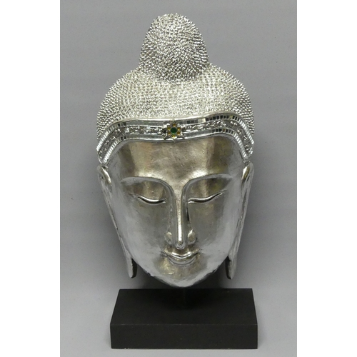 275 - A large silvered sculpture of Buddha's head. 58 cm high. UK Postage £25.