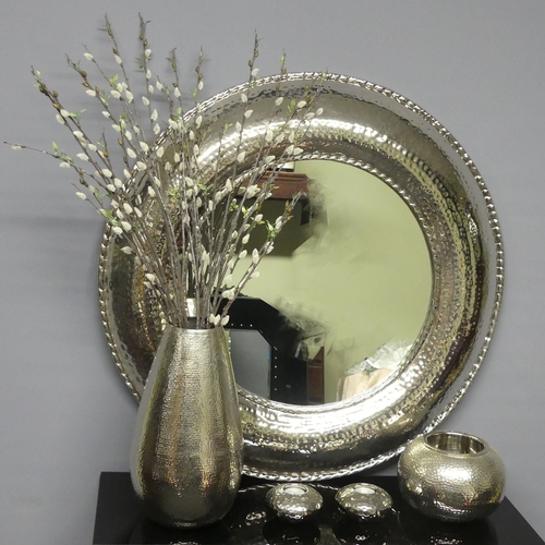 279 - A round chromed mirror, matching vase and candleholders. Mirror 82 cm. Vase 37 cm high.
