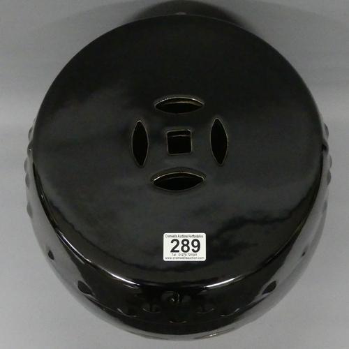 289 - A Chinese dark brown glazed garden seat. 43 cm high.