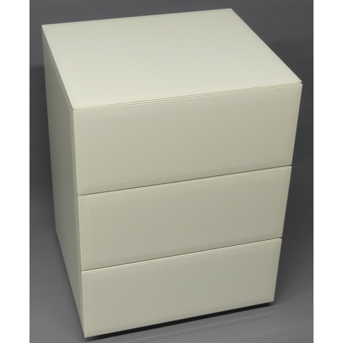 298 - A white bevelled glass chest of three soft close drawers.46 cm wide x 41 cm deep x 61 cm high.